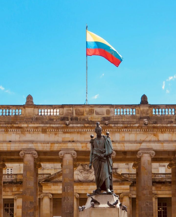 Flag on Plaza Bolivar in Bogota Colombia; Colombia Travel Blog Inspirations