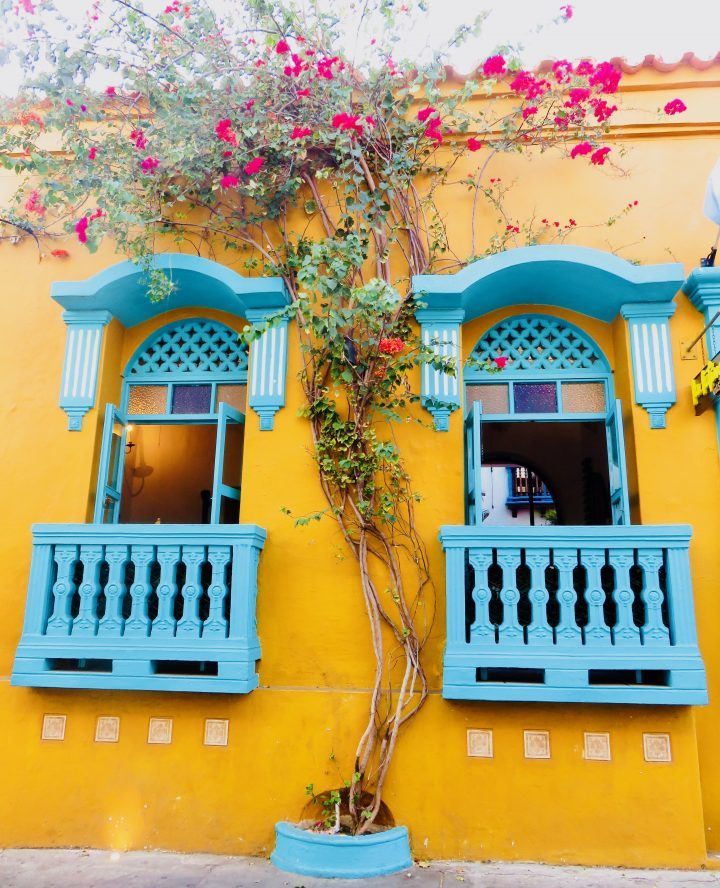 Colorful streets with flowers in Cartagena Colombia; Colombia Travel Blog Inspirations
