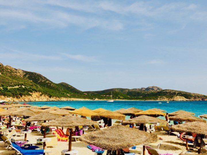 Cala Tuerredda umbrellas in South Sardinia, Sardinia Travel Blog Inspirations