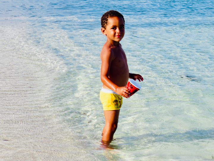 Local kid playing at the beach in Belize, Belize Travel Blog