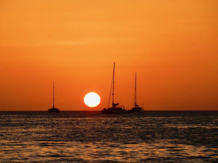 Sunset and sailing boats at the split on Caye Caulker Belize, Belize Travel Blog