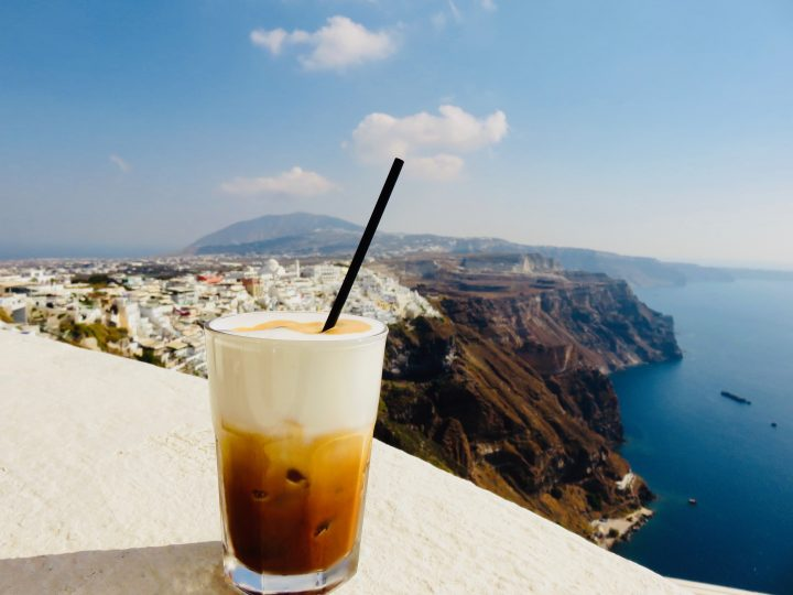 Restaurant bar Volkan drinking Freddo on Santorini Greece, Greek Cyclades travel Blog