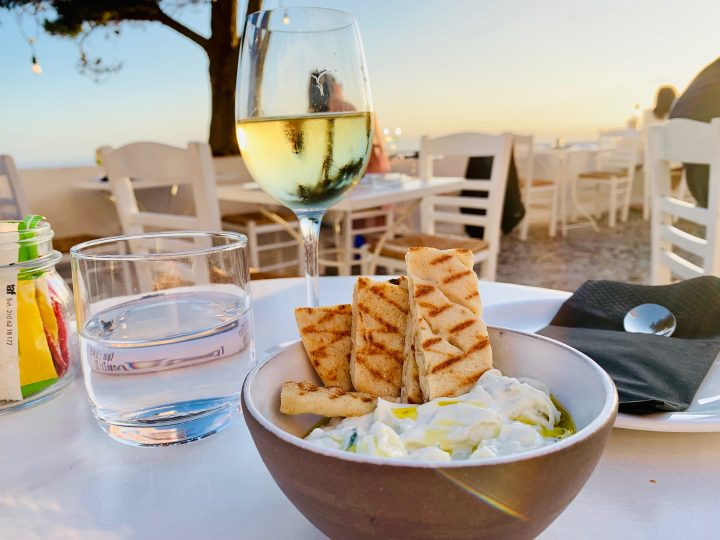 Restaurant bar Volkan drinking Wine on Santorini Greece, Greek Cyclades travel Blog