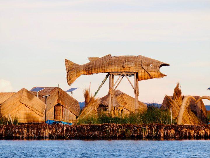 Big fish statue at the Islas Uros in Puno Peru, Travel blog Peru