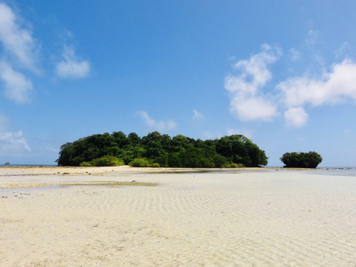 Walking with low tide to Janoyoy Island Surfing Siargao Philippines Travel Blog